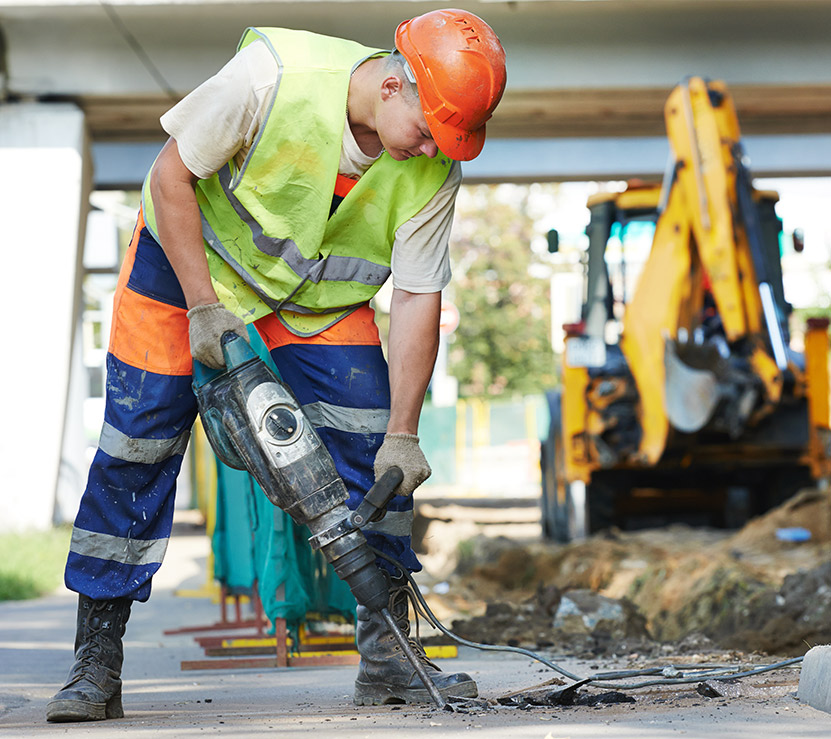 Construction worker with pneumatic power drill